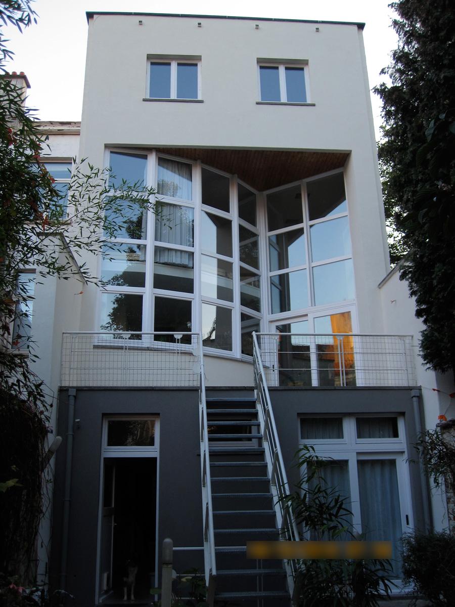 Après: Façade de maison après travaux de peinture extérieure